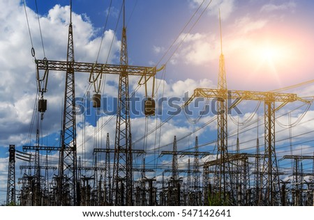 distribution electric substation with power lines and transformers, at sunset #547142641