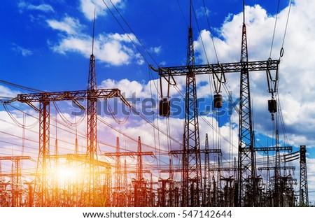 Sun setting over an electrical substation closeup #547142644