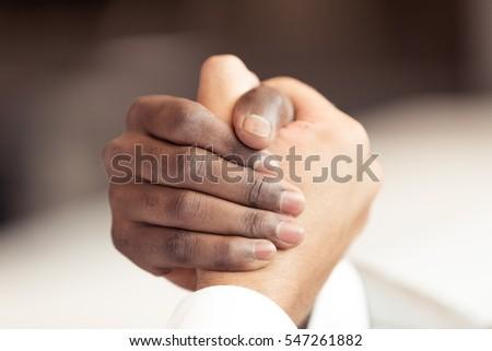 Handshake between african and a caucasian man #547261882