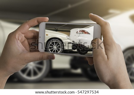 woman photographing his vehicle with damages for accident insurance with smart phone. The accident at the car park