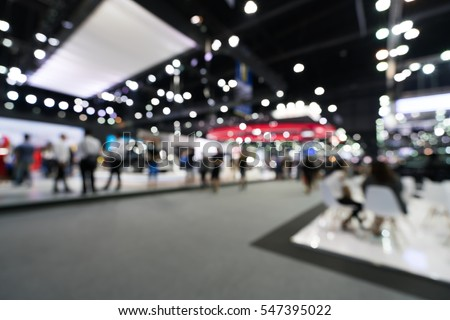 Blur, defocused background of public exhibition hall. Business tradeshow, job fair, or stock market. Organization or company event, commercial trading, or shopping mall marketing advertisement concept Royalty-Free Stock Photo #547395022