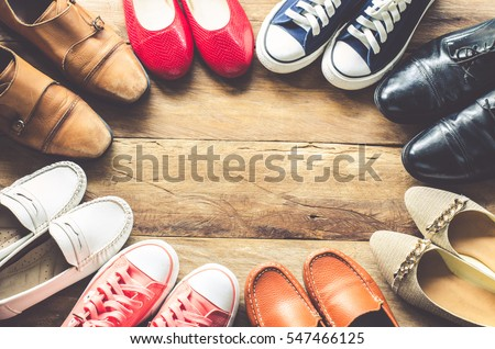 shoes various styles  on a wooden floor - lifestyles. Royalty-Free Stock Photo #547466125