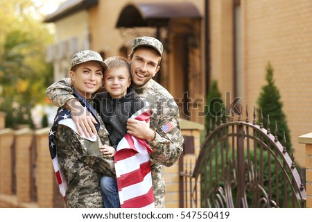 Military family reunited on a sunny day Royalty-Free Stock Photo #547550419
