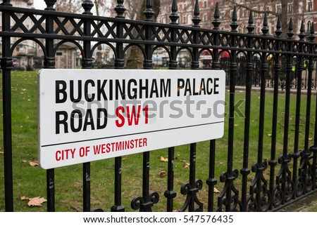 Buckingham Palace Road sign on the fence