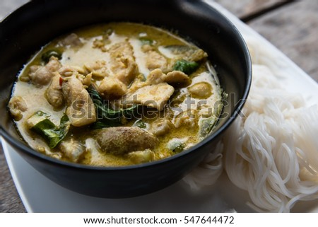 close up of chicken green curry served with white vermicelli #547644472