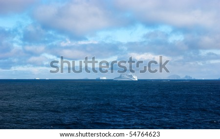 Antarctic ice island with penguins  in atlantic ocean #54764623