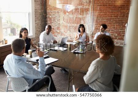 Group Of Businesspeople Meeting In Modern Boardroom #547750366