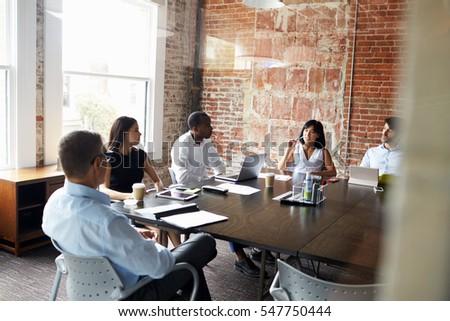 Group Of Businesspeople Meeting In Modern Boardroom #547750444