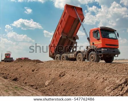 View of dump truck dumping earth #547762486