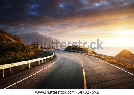 oad by the sea in sunrise time, Lofoten island, Norway #547827592