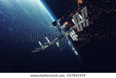 International Space Station over the planet Earth. Elements of this image furnished by NASA #547841959