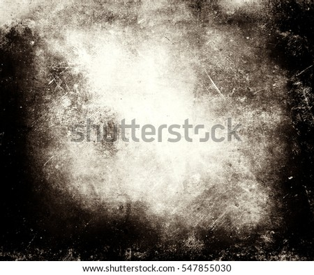 Scratched grungy texture with frame and faded central area for your text or picture useful as background #547855030