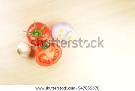 Tomatoes  ,garlic and half onion on the wooden background. #547855678