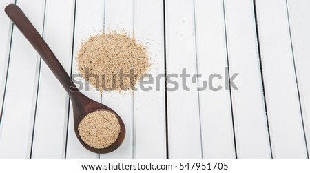 Super grain, white teff in wooden spoon over wooden background #547951705