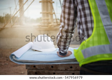engineer working on building site Royalty-Free Stock Photo #547956979