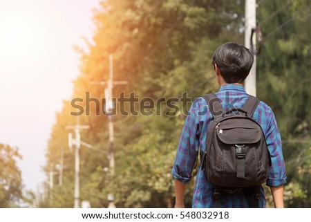 young man is traveling alone with the black bag #548032918