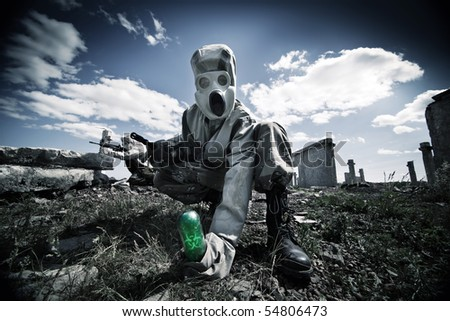 Two soldiers in the gas masks and protective clothes are testing biological weapon on the ruined background. #54806473