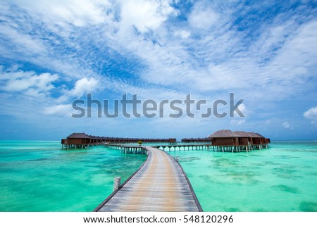 beach with water bungalows at Maldives #548120296