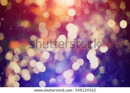 abstract blurred of blue and silver glittering shine bulbs lights background:blur of Christmas wallpaper decorations concept.xmas holiday festival backdrop:sparkle circle lit celebrations display. #548124562