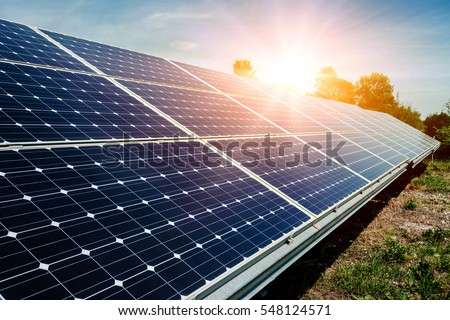 Solar panel, photovoltaic, alternative electricity source - selective focus, copy space Royalty-Free Stock Photo #548124571