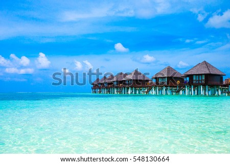 beach with water bungalows at Maldives #548130664