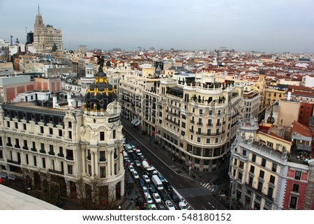 MADRID, SPAIN - DECEMBER 14, 2016: The aerial view of historical Metropolis Building and Gran Via main shopping street in Madrid, Spain. #548180152