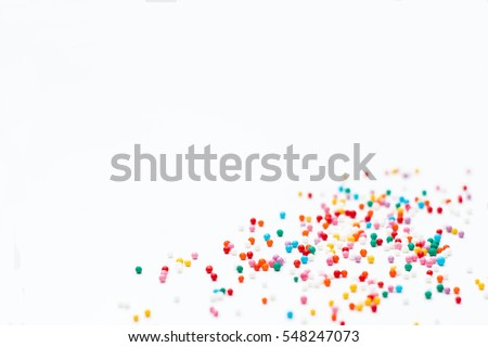 sprinkles on a white background. Festive background for Valentine's day, birthday, holiday, party Royalty-Free Stock Photo #548247073