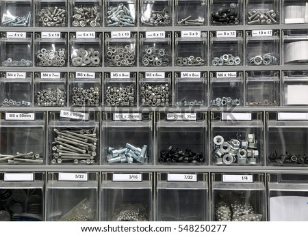 Many bolts and steel washers and iron in hardware store #548250277