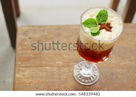 beautiful drink on old wood background #548339482