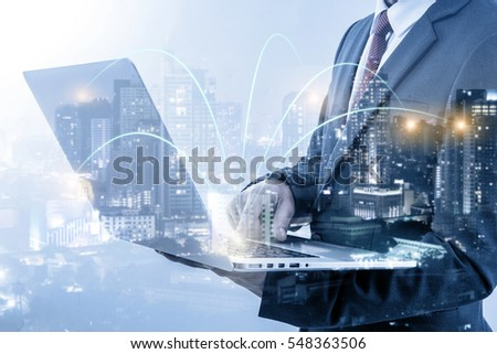 double exposure of businessmen using laptop with blur city night and network connection concept  #548363506