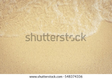 Soft wave of the sea on the sandy beach #548374336