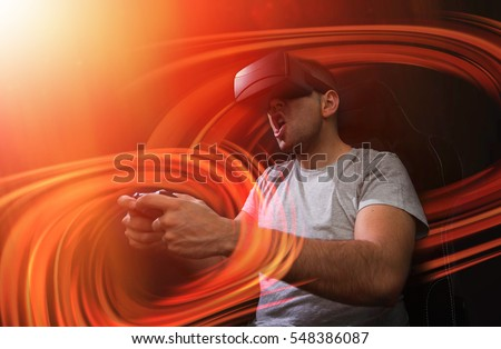 addicted young man playing a virtual reality video game; video game addiction futuristic concept