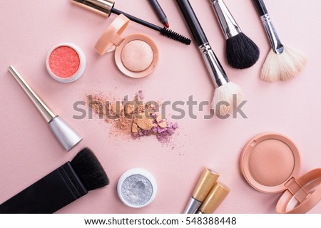 Makeup brush and cosmetics Royalty-Free Stock Photo #548388448