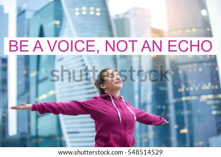 """Sporty healthy model feeling alive, enjoying bliss, fresh air, thanking for good weather, doing yoga, fitness outdoor, urban background. Photo with motivational text """"Be a voice, not an echo"""""""