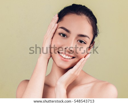 Beauty People Woman face Portrait. Beautiful Spa model Girl with Perfect Fresh Clean Skin. Brunette female looking at camera and smiling. Youth and Skin Care Concept. #548543713