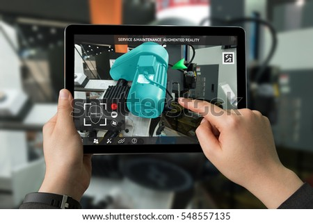 Industrial 4.0 , Augmented reality concept. Hand holding tablet with AR service , maintenance application and calling technician for check destroy part of smart machine motor in smart factory #548557135