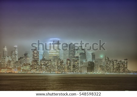 Manhattan cityscape at night in fog. Special foggy effect. Monochrome colors. #548598322