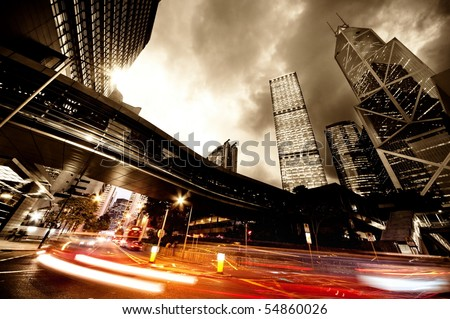 Fast moving cars at night Royalty-Free Stock Photo #54860026