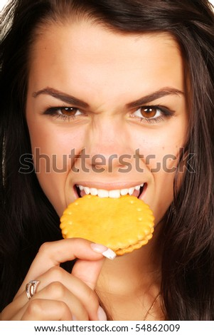 Woman eating cookie with anger #54862009