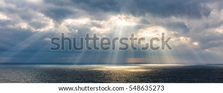 The sun's rays over the sea. #548635273