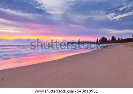 Dicky Beach sunrise in Caloundra on the Sunshine Coast, Australia #548818951