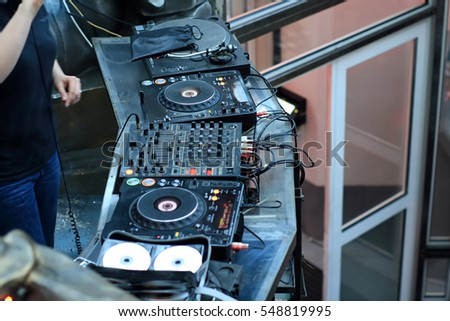 The disk jockey put music on the party #548819995