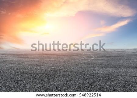 Asphalt road and sky at sunset