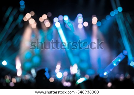 Defocused entertainment concert lighting on stage, blurred disco party and Concert Live. Royalty-Free Stock Photo #548938300
