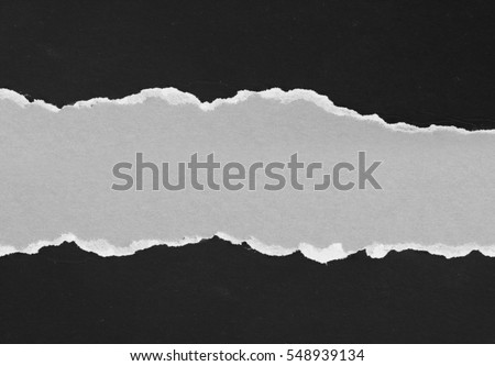 Piece of torn black paper, space for copy Royalty-Free Stock Photo #548939134