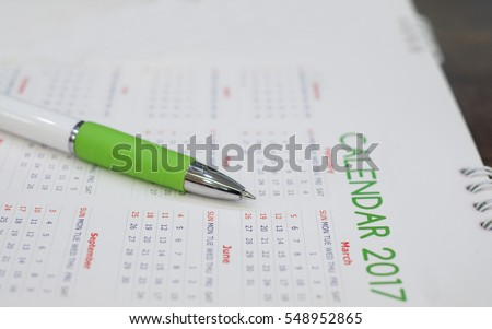 close up soft focus on pen over calendar 2017 at office desk concept