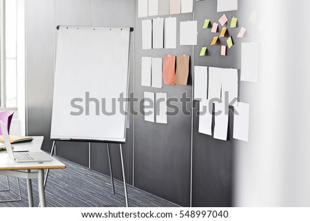 Flip chart by sticky notepapers on wall in office #548997040