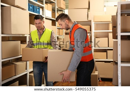 Young business people working at warehouse #549055375
