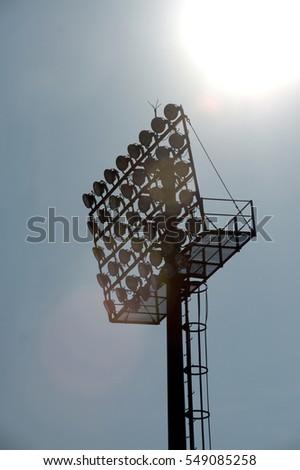 Silhouette of stadium lighting poles. #549085258