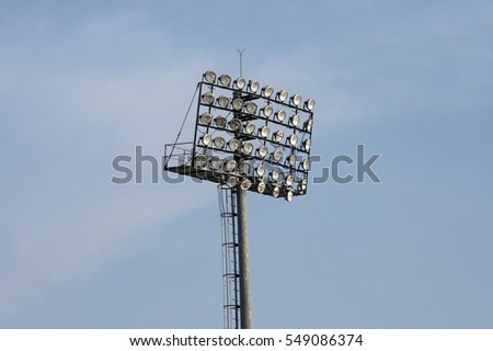 Stadium lighting poles in blue sky. #549086374